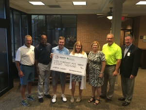 Don Padgett, Executive Director of the WGC-Bridgestone (third from left) along with John Hirschbeck (far left, Kevin Mack (second from left), Joe Charboneau ( second from right, yellow shirt) display the check for charity.