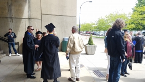 New graduates standing outside E.J. Thomas Hall