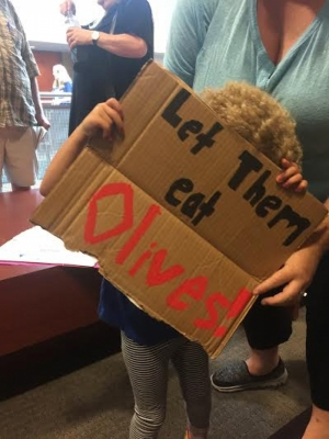 A child holds a sign during a protest at The University of Akron on Aug. 12.