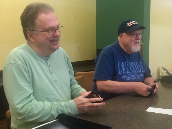 John Marshall, 66, (right) and James Neilsen, 65, (left), both of Stow, apply for a marriage license at the Summit County Probate Court.