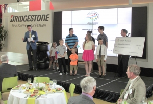Kids from Akron Children's Hospital and University Hospitals present Bridgestone Invitational check to local non-profits