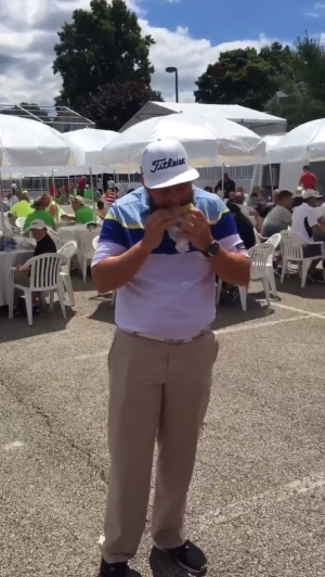 "Andrew ""Beef"" Johnston takes a bite of a Gally Boy at the Bridgestone Invitational"