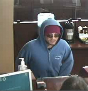 Teller Turns Back Would-Be Stow Bank Robber