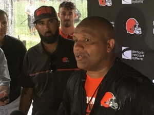 Hue Jackson speaking to the media at training camp earlier this year
