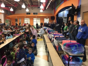 Akron Firefighters Deliver Coats To Students