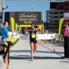 Emma McCarron crosses the finish line to win the 2017 Akron Marathon