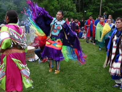 Northern Cheyenne dancers in traditional dress at The Lippman School in Akron.