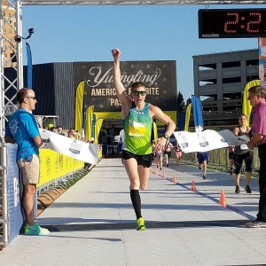 Blair Teal breaks the tape to win the Akron Marathon