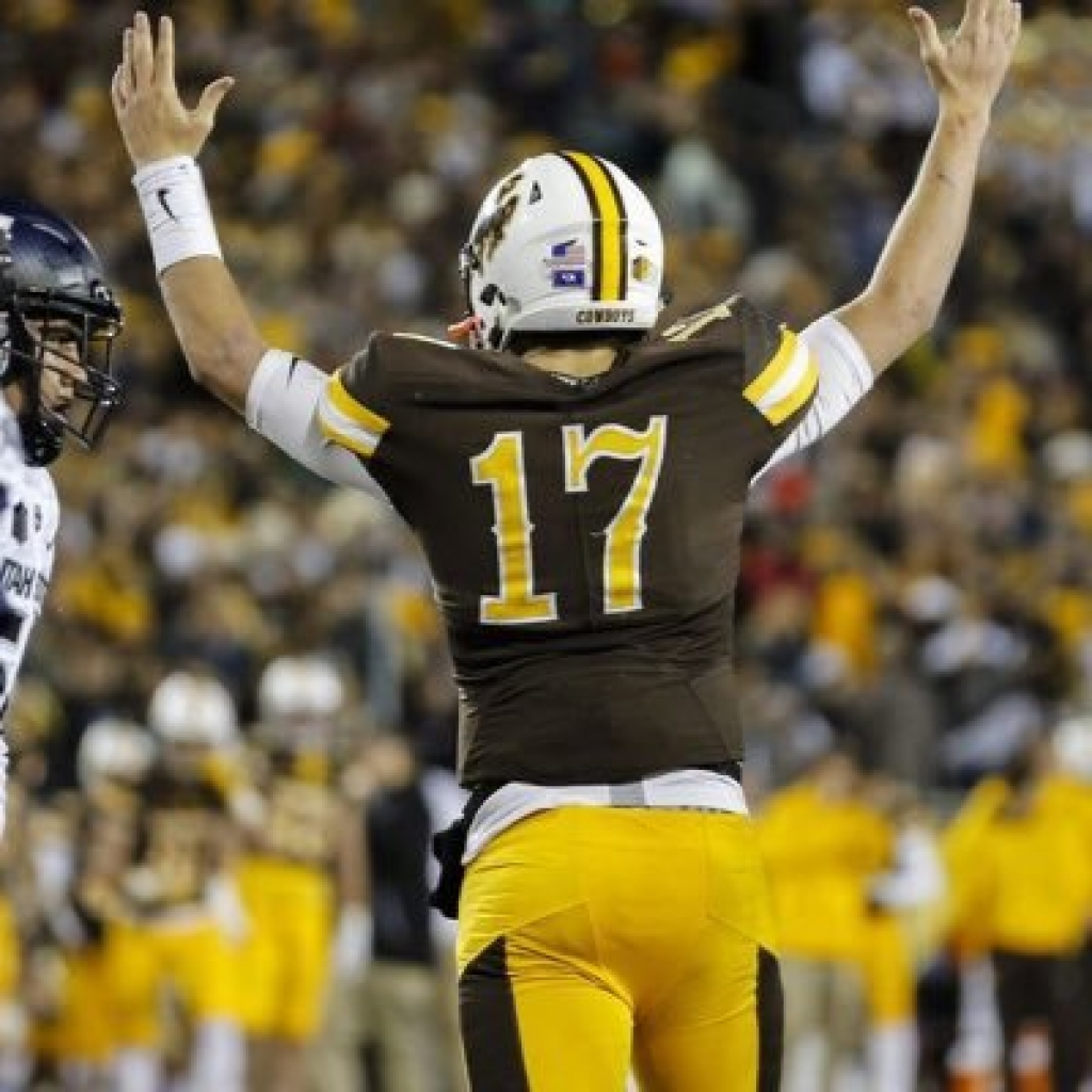 Josh Allen celebrates a TD throw as a member of Wyoming